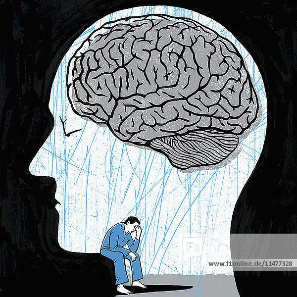 Deprimierter Mann in einem Kopf mit Gehirn