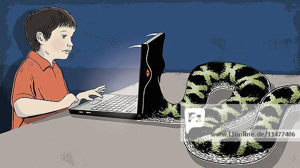 Schlange frisst den Laptop eines Jungen