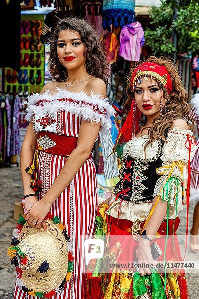 Two Moroccan Women In Costume  Chefchaouen  Morocco.