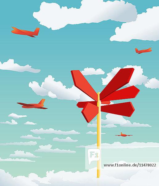Flugzeuge im Himmel und Wegweiser  der in verschiedene Richtungen zeigt Flugzeuge im Himmel und Wegweiser, der in verschiedene Richtungen zeigt