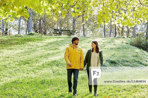 Couple walking in the forest  Pagoetako Parke Naturala  Pagoeta Natural Park  Aya  Gipuzkoa  Basque Country  Spain