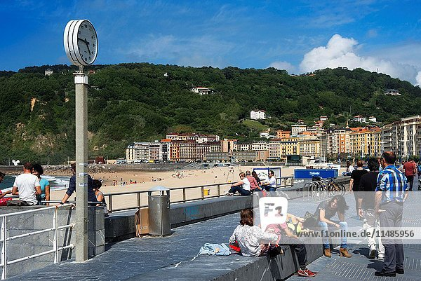 A view of the beautiful but crowded Playa de La Concha (Beach of Zurriola) in San Sebastián (Donostia)  Spain. One of the stops of the Transcantabrico Gran Lujo luxury train.
