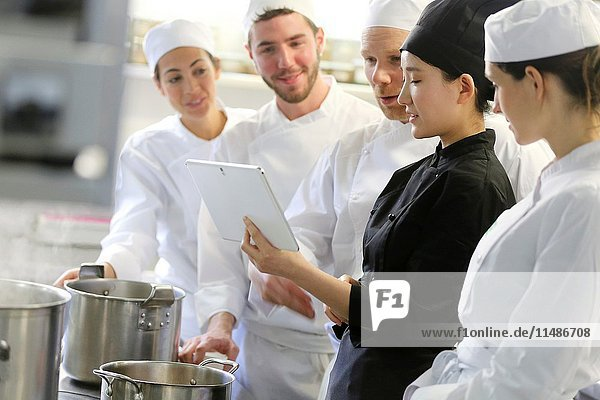 Chef with tablet  Cooks in cooking school  Cuisine School  Donostia  San Sebastian  Gipuzkoa  Basque Country  Spain  Europe