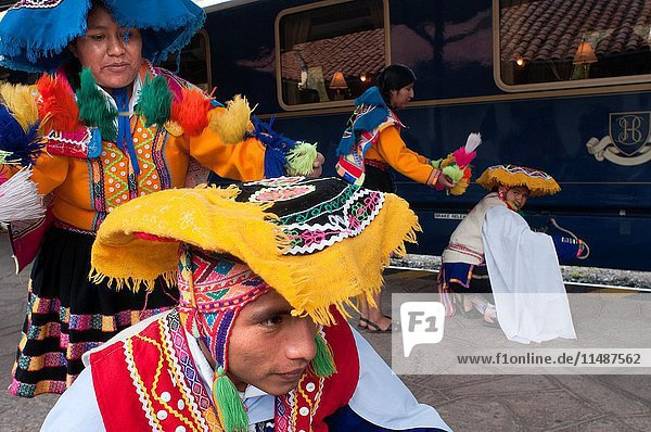 Peru Luxury train from Cuzco to Machu Picchu. Orient Express. Belmond. Musicians and dancers in traditional costumes brighten up the entry in the Hiram Bingham Orient Express which runs between Cuzco and Machu Picchu. For many  a trip to Machu Picchu is a once in a lifetime experience. The Belmond Hiram Bingham assures a magical journey  never to be forgotten.Named after the explorer who rediscovered the Inca citadel  the train has two dining cars  an observation/bar car and a kitchen car. It can carry up to 84 passengers.THE CARRIAGES. Decorated in the style of 1920s Pullman carriages  each has been furnished in polished wood and brass with large comfortable armchairs.Dining Cars. As you board  the tables are exquisitely set with gleaming crystal and polished cutlery. Our maître d' will invite you to enjoy brunch and a gastronomic dinner  specially created by our onboard chef.Bar Car. The bar car is the perfect place to enjoy a cocktail accompanied by live Peruvian music. On the way to Machu Picchu  our bartender will show you how to make a traditional Pisco Sour. Take the recipe home and impress family and friends.Observation Car. The observation car is furnished with large cushioned seats  making it the perfect place to sit  relax and watch the Peruvian landscape unfold.