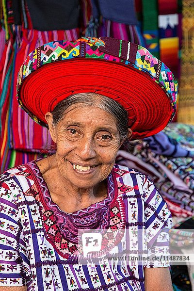 An older Mayan woman wearing traditional dress  including a tocoyal or head wrap tyipical of Santiago Antitlan. Twenty-five years ago  many women there wore them. Because they are expensive  most woman cannot afford them anymore. It is a piece of woven fabric about 40 feet long which is wrapped around the head. They are a symbol of status and authority for a woman.