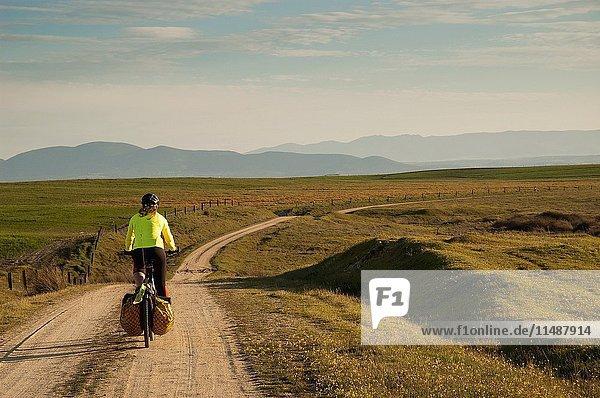 Bike traveller in Alcañizo  Toledo province  Castile LaMancha  Spain.