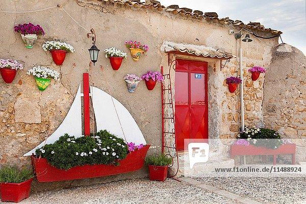 Exterior wall of a restaurant  Marzamemi  Sicily  Italy.
