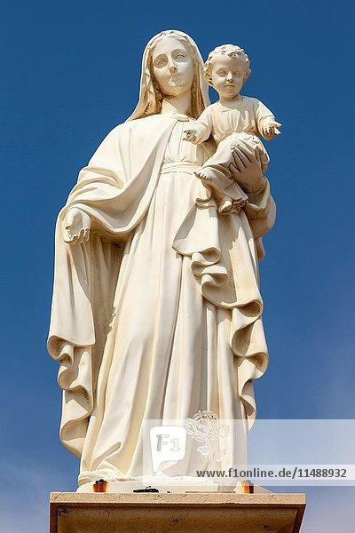 Statue of Mary holding baby Jesus  Punta Secca  Santa Croce Camerina  Sicily  Italy.