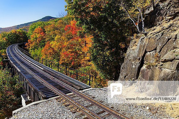 Crawford Notch State Park - Frankenstein Trestle along the old Maine Central Railroad in the Hart's Location  New Hampshire USA during the autumn months. Since 1995 the Conway Scenic Railroad  which provides passenger excursion trains has been using the track.