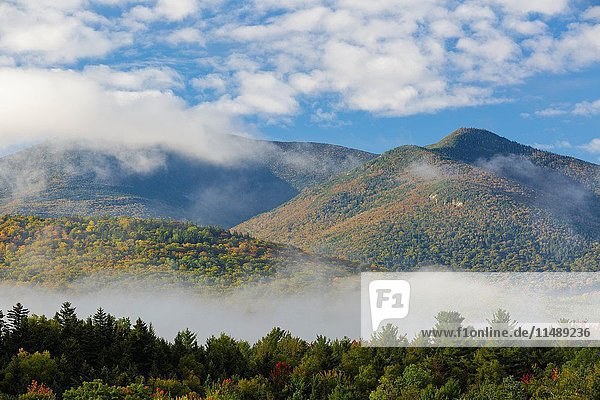 View of mountains on a foggy autumn morning from the information center at the junction of Route 302 and Route 3 in Twin Mountain  New Hampshire.