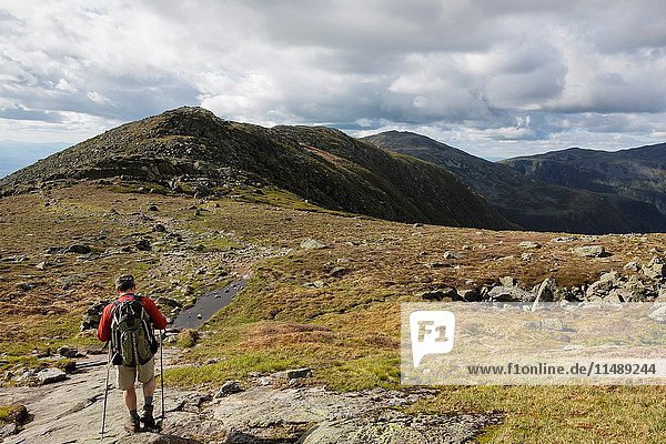 A hiker on the Appalachian Trail descending Mount Washington. Located in the White Mountains  New Hampshire USA.