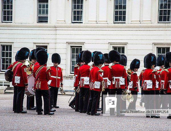 British Royal guards perform the Changing of the Guard in Buckingham Palace  London  England  UK.