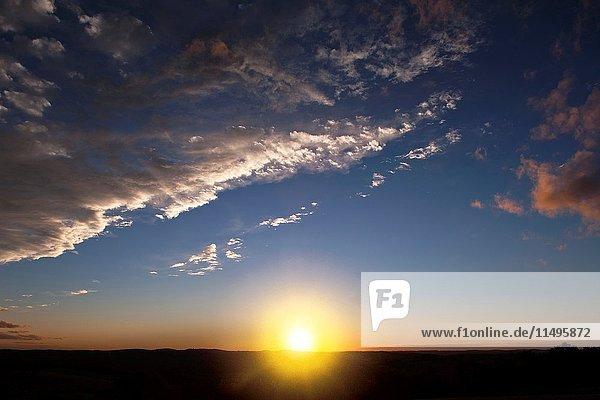 SUNSET OVER FLAT LAND HORIZON.