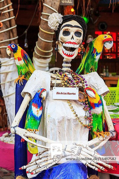 Plastic and wooden skeleton with artificial parrots  used to celebrate the ''Day of the Dead''  Dia de Los Muertos  Playa del Carmen  Riviera Maya  Mexico.