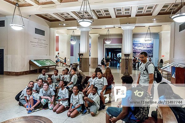 New York  New York City  NYC  Manhattan  Upper West Side  American Museum of Natural History  Theodore Roosevelt Rotunda  statue  sitting  posing  Boys and Girls Club  summer camp  class field trip  student