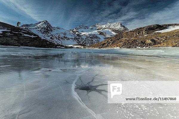 Bernina Pass  Switzerland. A photographer makes some pictures at Piz Bernina.