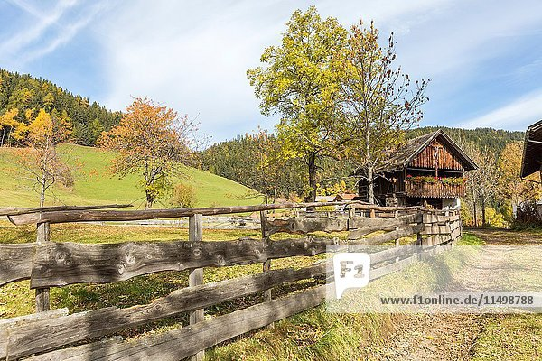 Autumnal scenery with mountain lodge and fence. Santa Maddalena  Funes  Bolzano  Trentino Alto Adige - Sudtirol  Italy  Europe.