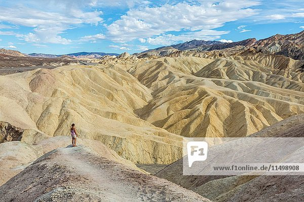 Woman admiring the landscape. Zabriskie Point  Death Valley National Park  Inyo County  California  USA.