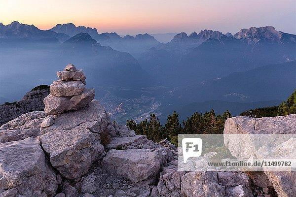 Europe  Italy  Veneto  Belluno. Sunrise from the First Pala di San Lucano summit towards Agordo. Agordino  Dolomites.