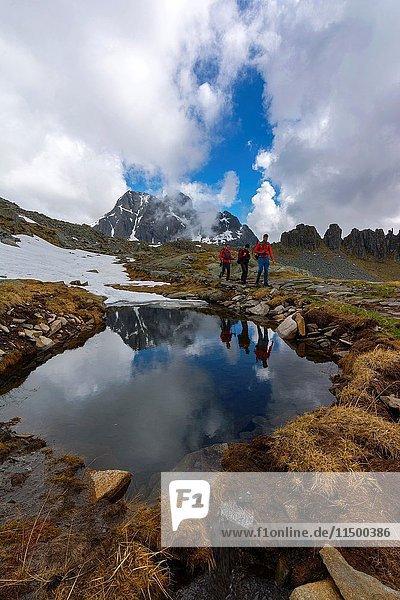 Hikers in the park Adamello  Valllecamonica Italian province of Brescia.
