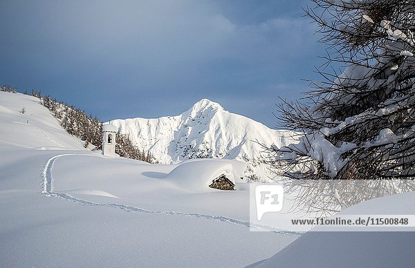 Tracks in the snow towards Alpe Scima created by hikers Valchiavenna  Valtellina Lombardy  Italy Europe.