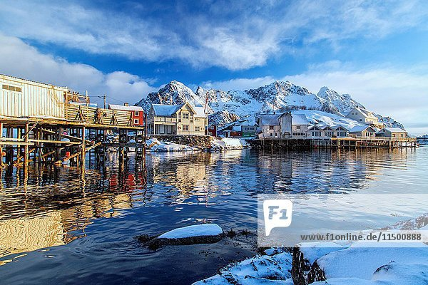 The houses of Henningsvaer port are heated by the sun. Lofoten Islands. Norway. Europe.