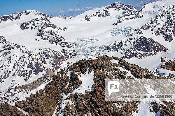 Aerial view of Forni Glacier and alpine skiers on Peak Dosegu Valtellina Valfurva Lombardy Italy Europe.