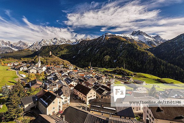 View of Ardez village surrounded by woods and snowy peaks Lower Engadine Canton of Graubünden Switzerland Europe.