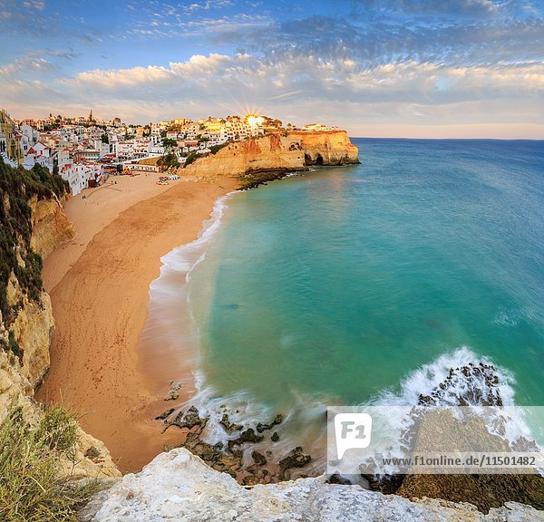 Panoramic view of Carvoeiro village surrounded by sandy beach and clear sea at sunset Lagoa Municipality Algarve Portugal Europe.