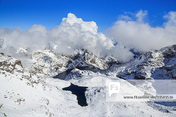 Aerial view of Lake Croce framed by snowy peaks and blue sky Spluga Valley Valtellina Lombardy Italy Europe.