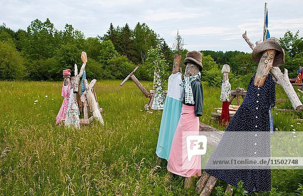 Eastport Maine on border of Canada and Maine with bright colors scarecrows for gardens