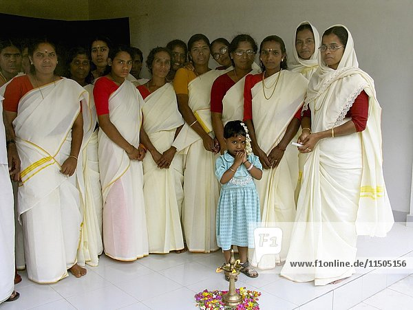 Traditionally dressed women in Kerala. India.