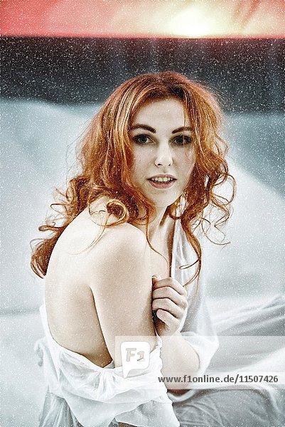 Redhair maiden portrait at unreal snow landscape.