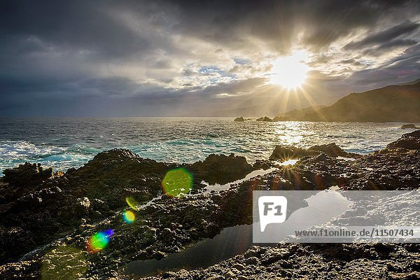 Lava rock coast at sunrise  Charco del Viento  La Guancha  Tenerife  Canary Islands  Spain.