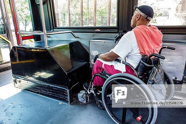 New York  New York City  NYC  Roosevelt Island  MTA public bus  Black  man  wheelchair  disabled  rider