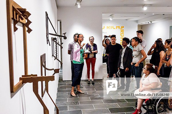 New York  New York City  NYC  Manhattan  Harlem  Studio Museum Harlem  interior  African American art  contemporary  gallery  exhibit  Richard Hunt  Framed and Extended  sculpture  installation  Black  woman  girl  teen  boy  guide  wheelchair  speaking  listening