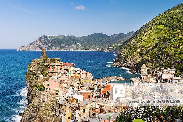 Vernazza  Cinque Terre  Liguria  Italy  Europe. Rooftops of Vernazza and Monterosso al Mare in the distance