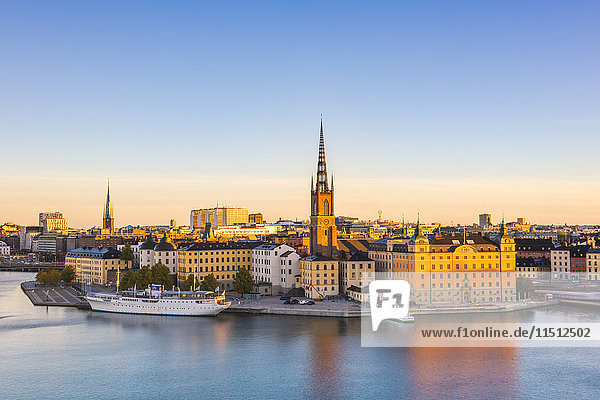 Stockholm  Sweden  Northern Europe. High angle view over Riddarholmen and Riddarholmskyrkan (church) at sunrise.