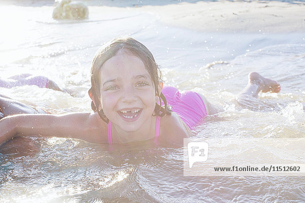 Girl playing in water with friends