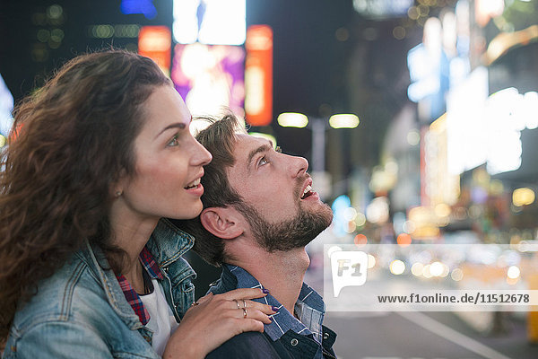 Young couple sightseeing in Times Square  New York City  New York  USA