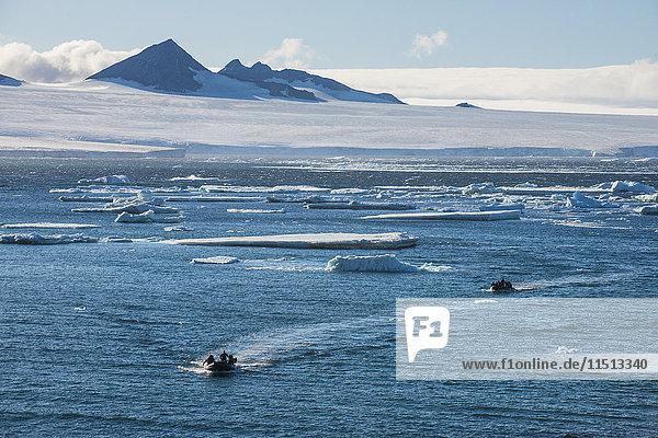 Zodiac with tourists cruising through the icebergs  Brown Bluff  Tabarin Peninsula  Antarctica  Polar Regions