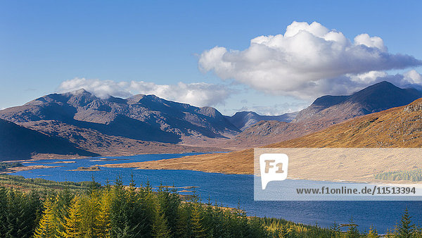 The road to the Scottish Highlands passing Loch Loyne and the distant mountains  Scotland  United Kingdom  Europe