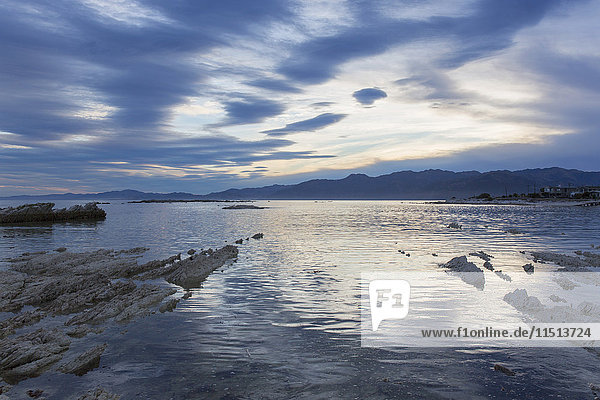 View across the tranquil waters of South Bay at dusk  Kaikoura  Canterbury  South Island  New Zealand  Pacific