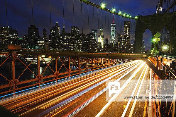 Light trails on Brooklyn bridge  New York  USA