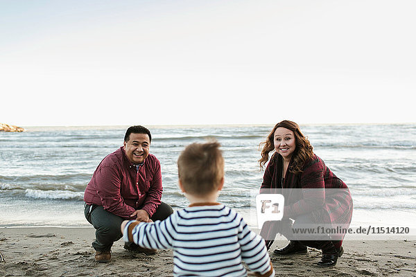 Family on beach with baby boy