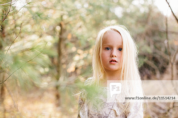Blond-haired girl in forest