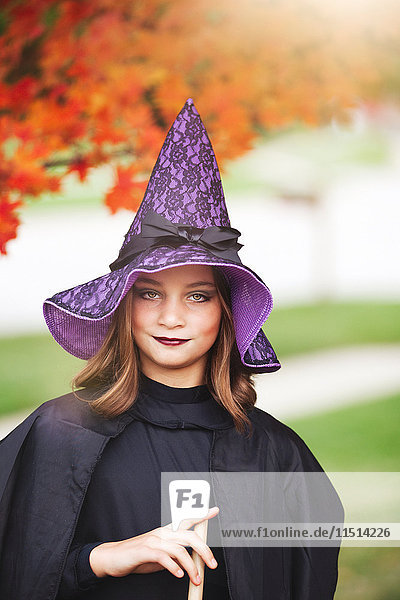 Girl dressed as witch for Halloween