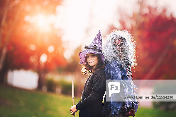 Friends dressed as witch and zombie