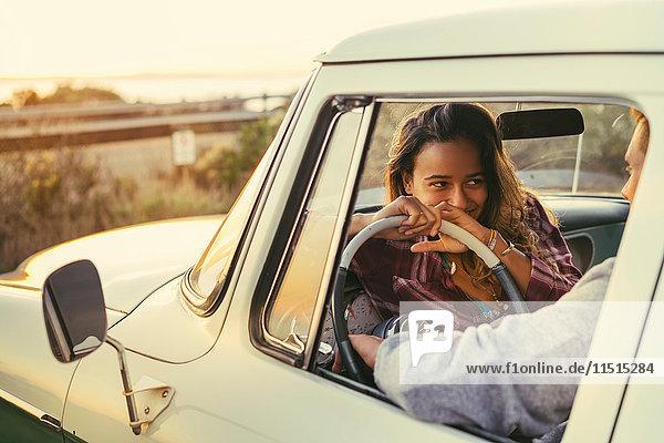 Romantic couple in pickup truck at Newport Beach  California  USA