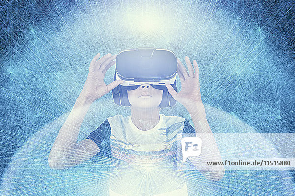 Mixed Race boy wearing VR goggles in cyberspace